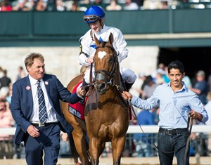 Terry Hamilton (left) leads Heart to Heart and jockey Julien Leparoux to the winner's circle at Keeneland
