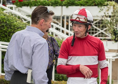 Jockey Stewart Elliott, right, celebrates with trainer Kenneth Black, left, in the winner's circle after What a View's victory in the G3, $100,000 American Stakes, Saturday, April 21, 2018 at Santa Anita Park, Arcadia CA.