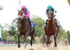 City of Light (outside) edges Accelerate by a neck to win the Oaklawn Handicap at Oaklawn Park