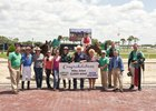 Friends and family join jockey Mike Allen in Tampa Bay Downs winner's circle after he secured the 2,000th victory of his career