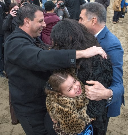 Owners Mike Repole, left and Vince Viola, right celebrate after winning with Vino Rosso with jockey John Velazquez wins the 94th running of The Wood Memorial at Aqueduct Saturday April 7, 2018 in Ozone Park, N.Y. In the scrum is Repole's wife and a crying child.