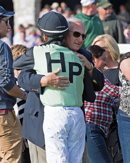 Trainer Scooter Dickey hugs Landeros. One Go All Go with Chris Landeros wins Dixiania Elkhorn (G2) at Keeneland on Dec. 31, 2015 Keeneland in Lexington, Ky.