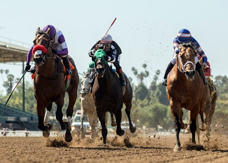 Reddam Racing's B Squared and jockey Mario Gutierrez, left, outleg Make It a Triple (Edwin Maldonado), second from left, and Tough Sunday (Joseph Talamo), right, to win the $100,000 Thor's Echo Handicap, Saturday, April 14, 2018 at Santa Anita Park, Arcadia CA.