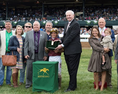 PRES: owner Paul Parker in gray suit/purple shirt, Dan Issel presenting. Rated R Superstar with Javier Castellano up wins the Ben Ali (G3) at Keeneland on April 14, 2018 Keeneland in Lexington, Ky.