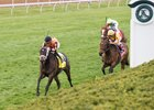 Triple Chelsea leaves Lady Aurelia (No. 8) in her wake in the Giant's Causeway Stakes at Keeneland