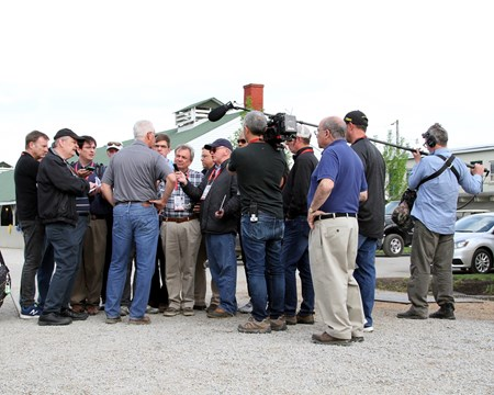 Todd Pletcher talking with the press outside his barn at Churchill Downs on May 2, 2018