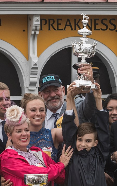 The Wolf family in the winner's circle after Justify wins the 143rd running of the Preakness Stakes