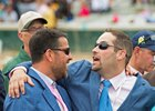 Sol Kumin (left) and trainer Brad Cox celebrate Monomoy Girl's Kentucky Oaks