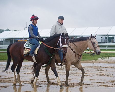 D. Wayne Lukas rides Starbuck the pony to accompany Sporting Chance at Pimlico Race Course
