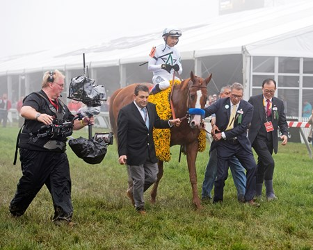 Jimmy Barnes, left, with owners Kenny Troutt and Teo Ah Khing. Justify with Mike Smith wins the Preakness Stakes (G1) at Pimlico during Preakness week on May 19, 2034 Pimlico in Baltimore, Maryland.