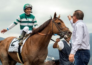 Victor Espinoza returns aboard Accelerate after winning the Gold Cup at Santa Anita Park