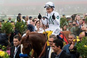 Justify with jockey Mike Smith enters the winner's circle after winning the 143rd running of the Preakness Stakes