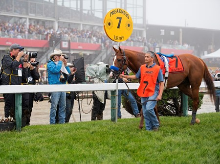 In the paddock with media and groom Eduardo Luna. Justify with Mike Smith wins the Preakness Stakes (G1) at Pimlico during Preakness week on May 19, 2034 Pimlico in Baltimore, Maryland.