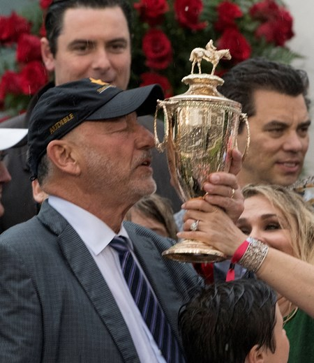 Jack Wolf of Starlight Racing kisses the trophy after Justify won the 144th running of the Kentucky Derby May 5, 2018 at Churchill Downs in Louisville, Kentucky