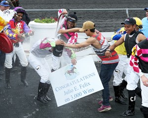 Julio Felix is doused by his fellow jockeys after riding his 3,000th winner