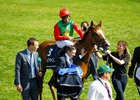 Billesdon Brook heads to the winner's circle after the One Thousand Guineas at Newmarket