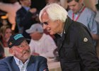 Jack Wolf (left) talks things over with trainer Bob Baffert at the Preakness Stakes draw at Pimlico Race Course