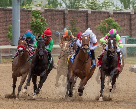 Mia Mischief (white cap) leads the field as they turn for home in the the Eight Belles at Churchill Downs