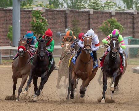 MIa Mischief (white cap),  Richardo Santana aboard, leads the field of the The Eight Belles (G2) at Churchill Downs.