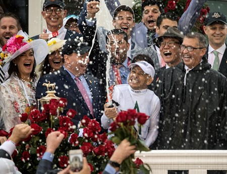 Jockey Mike Smith sprays the champagne after he wins the 144th running of the Kentucky Derby with Justify May 5, 2018 at Churchill Downs in Louisville, Kentucky