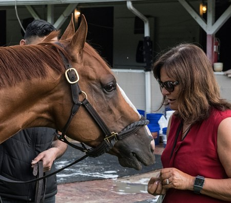 Good Magic gets some mints from owner Barbara Banke at Churchill Downs Wednesday May 2, 2018