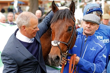 Clive Cox (left) with Harry Angel after winning the Duke of York Stakes at York