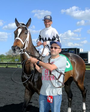 Carlos H. Marquez Jr. returns after his 3,000th win in a claiming race at Arlington International Racecourse