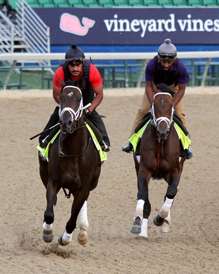 Noble Indy (left) and Magnum Moon (right) on the track at Churchill Downs on May 3, 2018