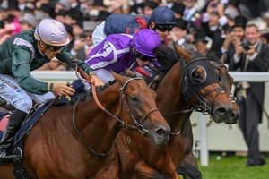 Merchant Navy and jockey Ryan Moore (purple cap) edge City Light (left) in the Diamond Jubilee at Royal Ascot