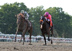 Supreme Aura (outside) battles through the stretch with Roaming Union to win the Pegasus by a neck at Monmouth Park