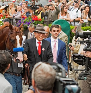 China Horse Club's Teo Ah Khing leads Justify into the winner's circle at Belmont Park