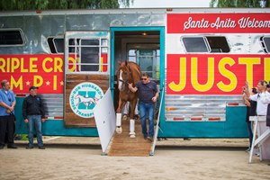 Justify arrives at Santa Anita and led by assistant trainer Jimmy Barnes