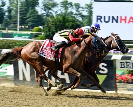 Bee Jersey out duels Mind Your Biscuits to the wire to win the 125th running of the Met Mile at Belmont Park June 9, 2018.