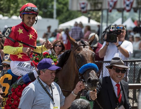 Owner Tea Ah Khing leads Abel Tasman with jockey Mike Smith to the winner's circle after winning the 88th running of The Grade 1 Ogden Phipps at Belmont Park Saturday June 9, 2018