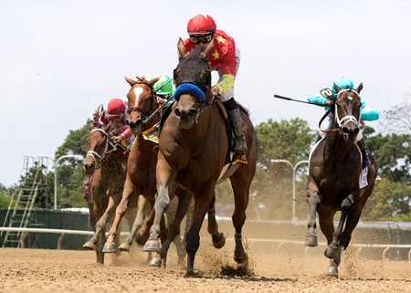 Abel Tasman and Mike Smith turning for home in the Ogden Phipps at Belmont Park on June 9, 2018.