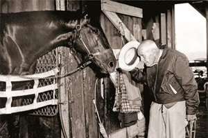 "Trainer J.E. ""Sunny Jim"" Fitzsimmons tips his hat to Bold Ruler. 1958"