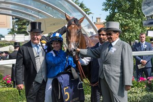 Sir Michael Stoute (left) with jockey Jim Crowley and Sheikh Hamdan Al Maktoum (far right) in the winner's enclosure with Eqtidaar