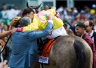 Co-owner Michael Dubb embraces Irad Ortiz Jr. after A Raving Beauty's Just a Game score