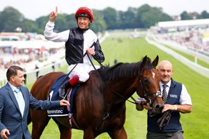 Cracksman and jockey Frankie Dettori after winning the Investec Coronation Cup at Epsom