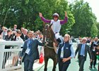 Laurens and jockey P J McDonald enter the winner's circle following their victory in the French Oaks