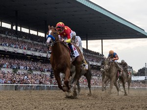 Justify with jockey Mike Smith wins the 150th running of the Belmont Stakes and the coveted Triple Crown of Thoroughbred race at Belmont Park Saturday June 9, 2018, in Elmont, N.Y.