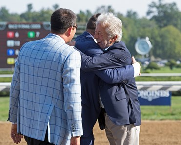 Owners Robert LaPenta hugs Ron Moquett as Sol Kumin looks on. Whitmore with Ricardo Santana Jr. wins Forego. Saratoga Aug. 25, 2018 Saratoga in Saratoga Springs, New York.