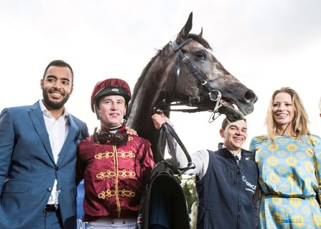 Roaring Lion in the winner's circle with connections after the Irish Champion Stakes at Leopardstown