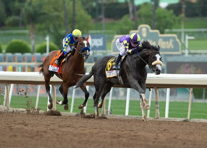 C R K Stable's Honor A.P. and jockey Mike Smith, right, glide by Authentic (Drayden Van Dyke) in mid-stretch and to on to win the Grade I $400,000 RUNHAPPY Santa Anita Derby Saturday, June 6, 2020 at Santa Anita Park, Arcadia, CA. ©Benoit Photo