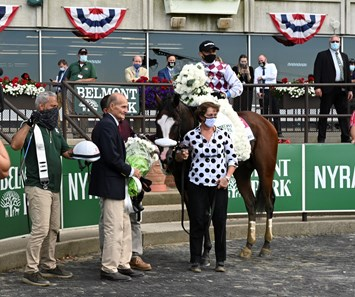 Tiz the Law in Belmont Stakes winner's circle. Barclay Tagg (left in blue jacket), hidden barn foreman Juan Barajas Saldana, and Robin Smullen at Belmont Park on Belmont Stakes Day June 20, 2020