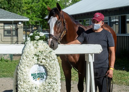 Sackatoga Stable's Tiz The Law, trained by Barclay Tagg, the 2020 Belmont Stakes, (GR I), winner, the morning after his win, with barn foreman Juan Barajas Saldana, as he smells his blanket of carnations, Sunday, June 21, 2020