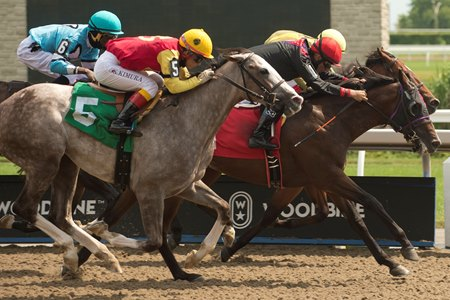 Exceed (red cap) ekes out a maiden score at Woodbine