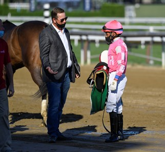 Jockey Manny Franco speaks with trainer George Weaver after a race at the Saratoga Race Track July 2020.