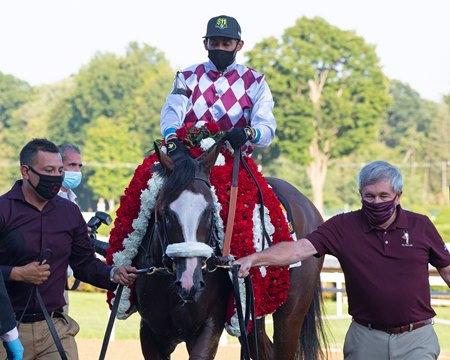 Tiz the Law enters the winner's circle after the 2020 Travers Stakes at Saratoga Race Course