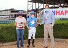 (L-R): Tessa Bisha, who oversees trainer Brad Cox's Ellis Park operation, and jockey Joe Talamo accepted the trophies for leading trainer and rider from racing secretary Dan Bork